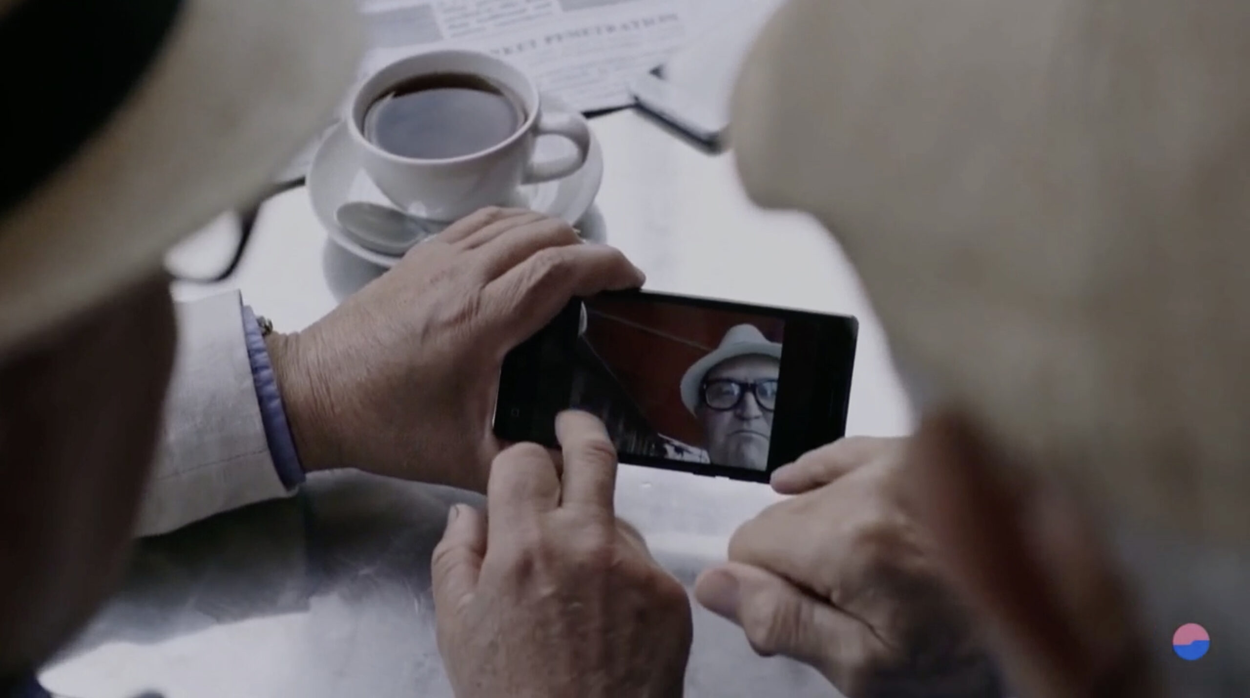 Two senior citizens video calling on cellphone