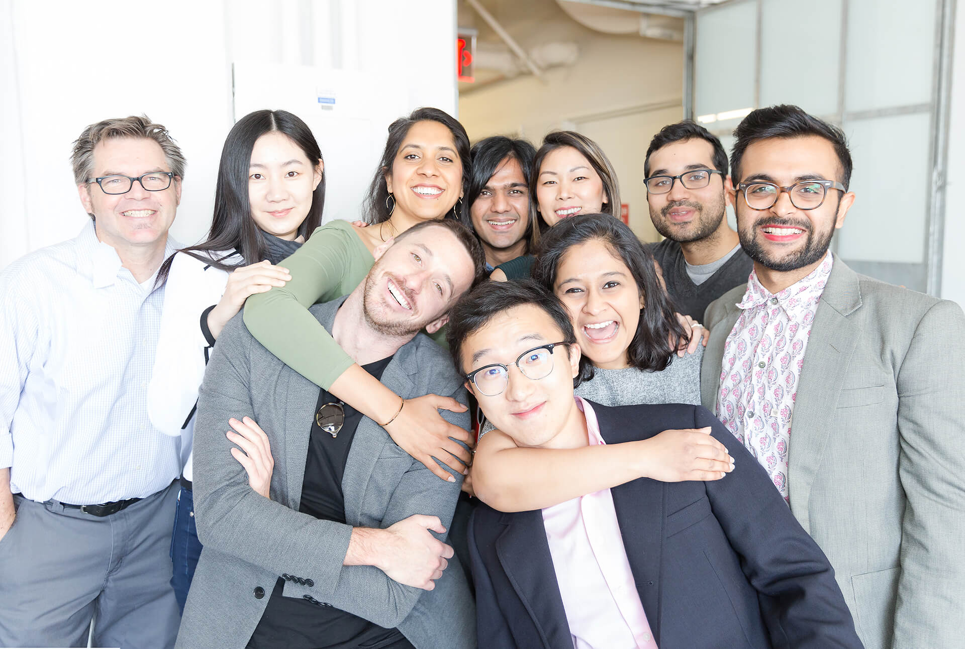 Group of IDM students embracing each other