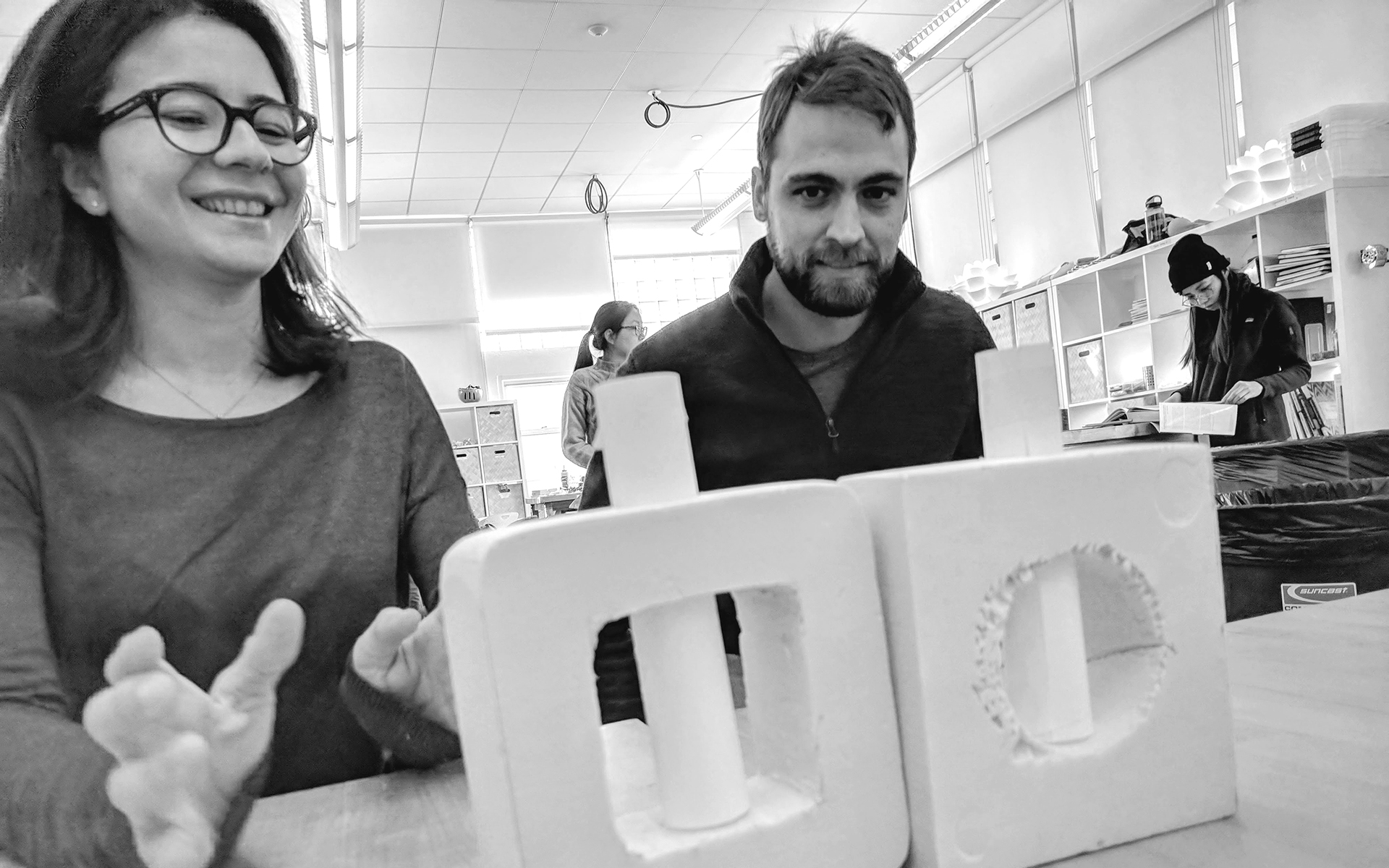 Two IDM students showcasing their prototype
