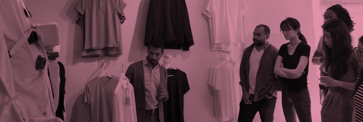 IDM students visiting a store showcasing shirts
